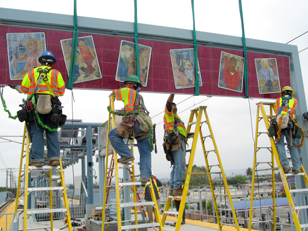 Gateway arch art panel being installed