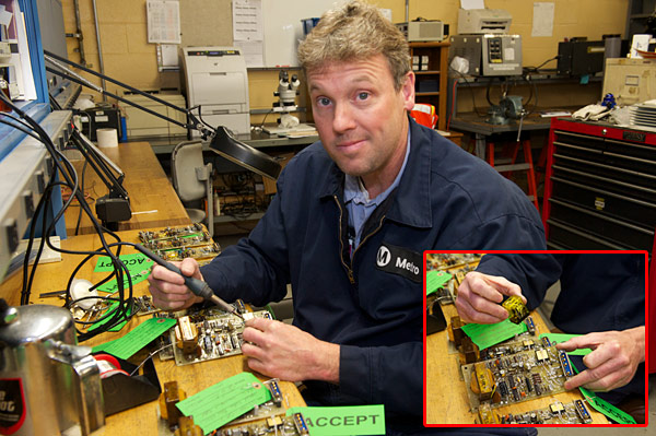 Maintenance specialist Steve Parker modifies a circuit board. Parker and co-worker Gordon Lancaster keep the shop in stock in hard-to-find circuitry replacement parts.