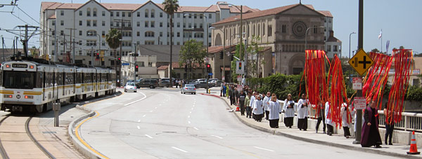 Congregation of St. John's Cathedral in downtown Los Angeles keeps pace with approaching Expo train. Photo by Luis Inzunza.