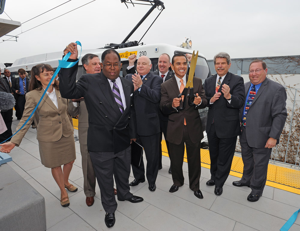 Los Angeles Mayor Antonio Villaraigosa leads opening day festivities for new Expo Line stations at Culver City Station. From left, Culver City council members Meghan Sahli-Wells, Jim B. Clarke, Los Angeles County Supervisor Mark Ridley-Thomas, Culver City Mayor Andy Weissman, Culver City Councilman Michael O'Leary, Mayor Villaraigosa, Los Angeles County Supervisor Zev Yaroslavsky and Los Angeles City Councilman Paul Koretz. Photos by Juan Ocampo.