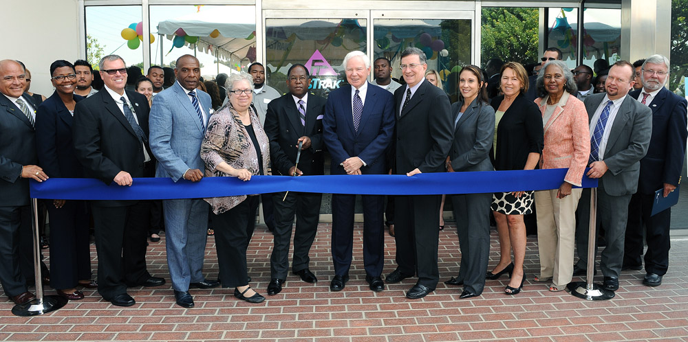 Mark Ridley-Thomas, LA County Supervisor and Metro Board member, leads the ribbon-cutting ceremony July 25 to open the Metro ExpressLanes Customer Service Center. Included among the officials are John Fasana, Duarte Mayor & Metro Board member; Pam O'Connor, Santa Monica City Councilmember, Metro Board member & SCAG Board member; Michael Miles, Caltrans District 7 Executive Director; Art Leahy, Metro CEO; Stephanie Wiggins, Metro EO, Congestion Reduction Initiative Program; Kathleen Daly, Program Manger, AAA Discounts;Jim Thomas, Thomas Properties Group and former Metro Director and Los Angeles County Supervisor Yvonne Burke.