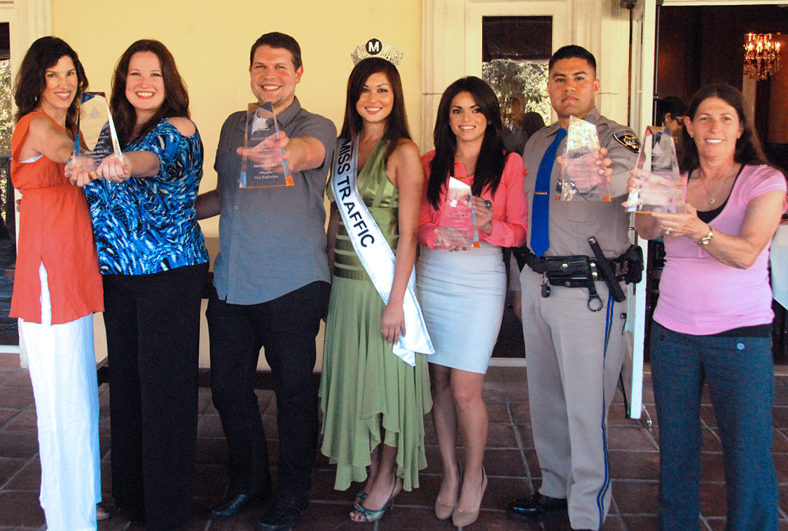 Winners of the 2012 Golden Pylon Awards: from left, carpooling team of Nora Wells and Sioux-z Jessup report traffic on several radio stations, Total Traffic L.A. powerhouse Nick Pagliochini, Metro's reigning 'Miss Traffic' Sofia Mach, KABC Air Watch Kalyna Astrinos, CHP Officer Juan Galvin, and KFWB veteran Rhonda Kramer.