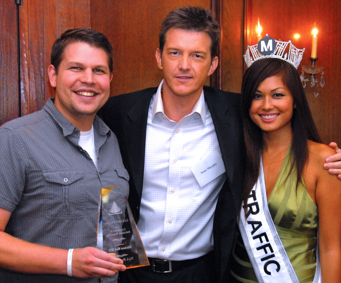 2011 winner Sean Murphy, center, NBC-4's prime time traffic reporter with Miss Traffic and 2012 winner Nick Pagliochini.
