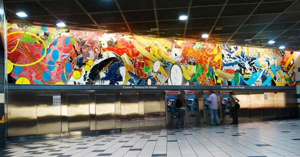 Artist Stephen Johnson's 58-foot long mural, titled Universal Delights, at Universal City Station.