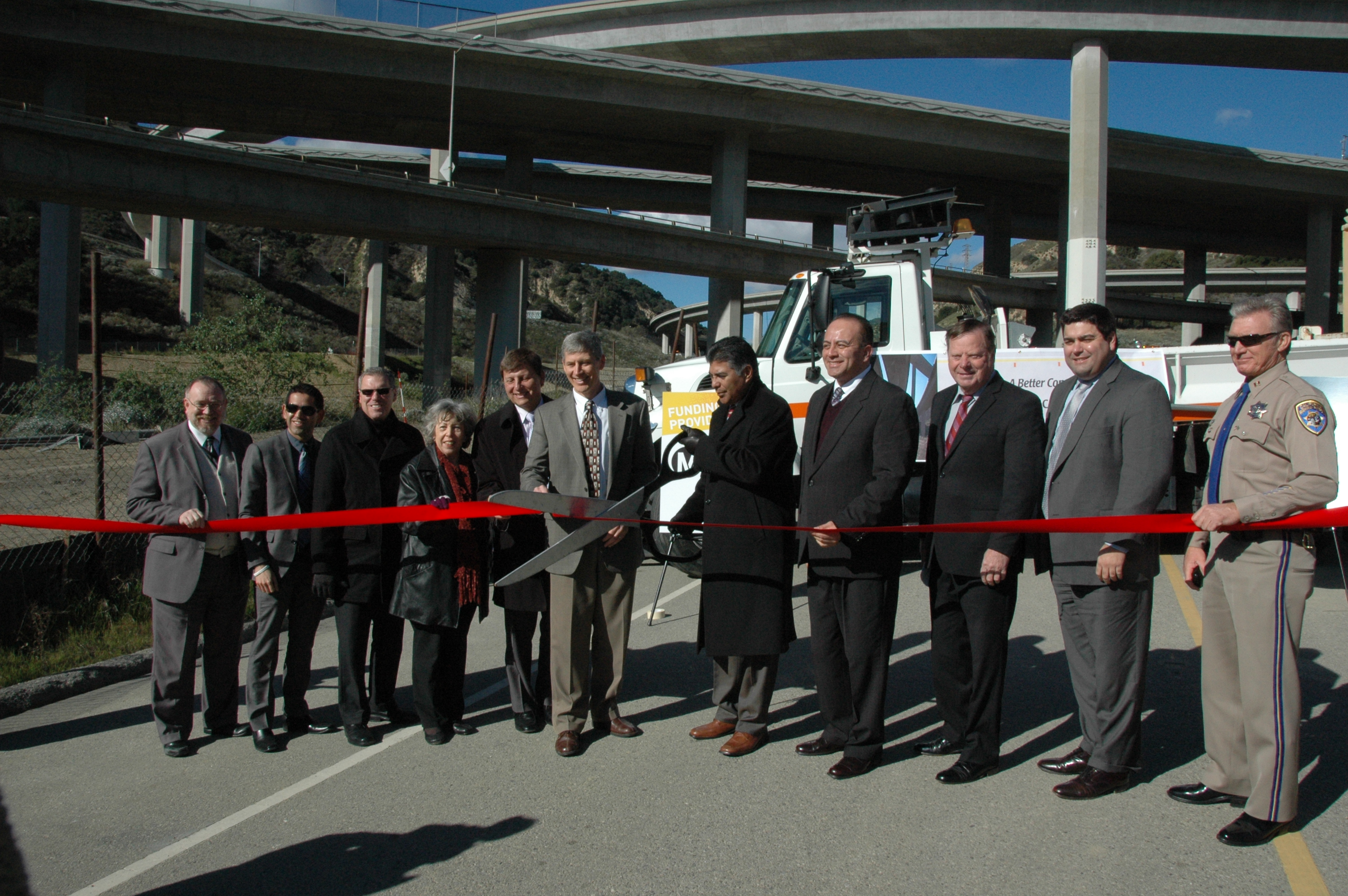 Officials cut the ribbon on the new HOV connector this morning. Rep. Tony Cardenas is holding the scissors. Photos by Luiz Inzunza/Metro.