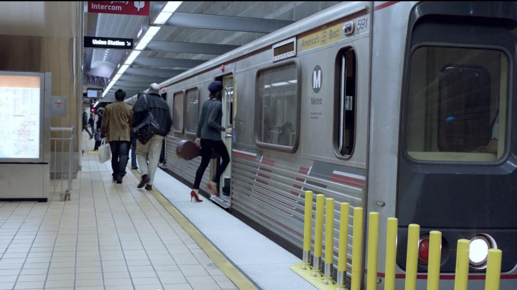 A woman steps inside a Metro train in a new Google ad.