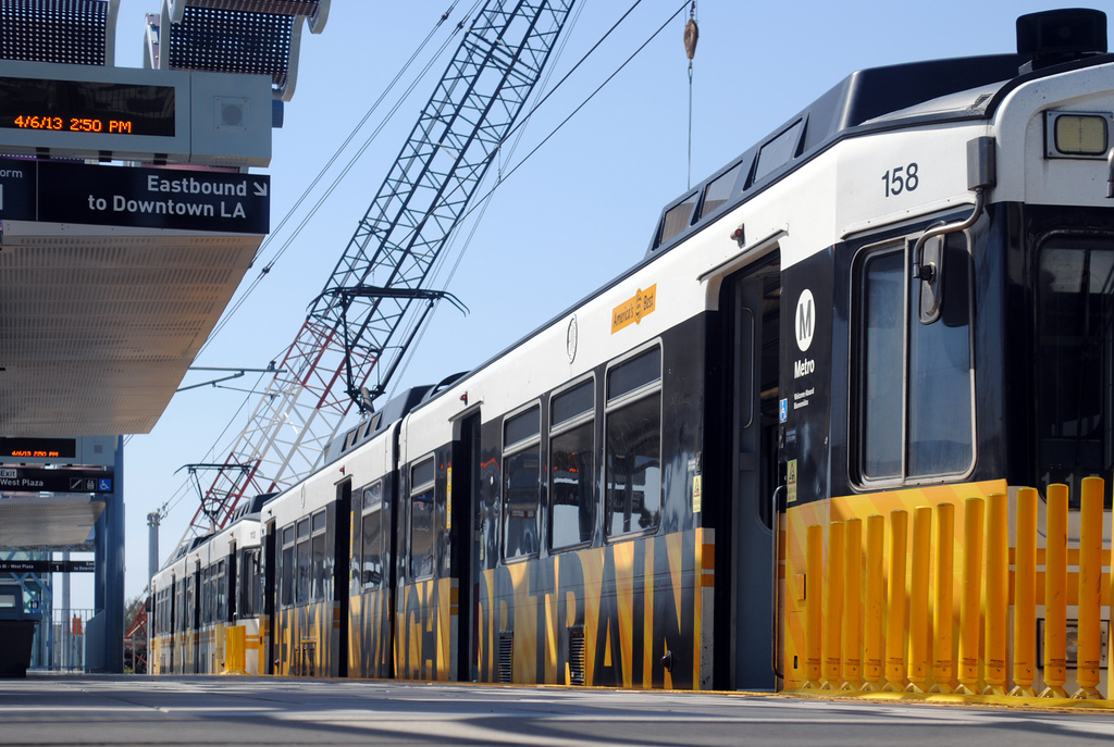 ART OF TRANSIT: Nice shot of an eastbound Expo Line train at Culver City station. The crane in the background is building the bridge that will take the train over Venice Boulevard. Photo by Brian Hsu, via submission.