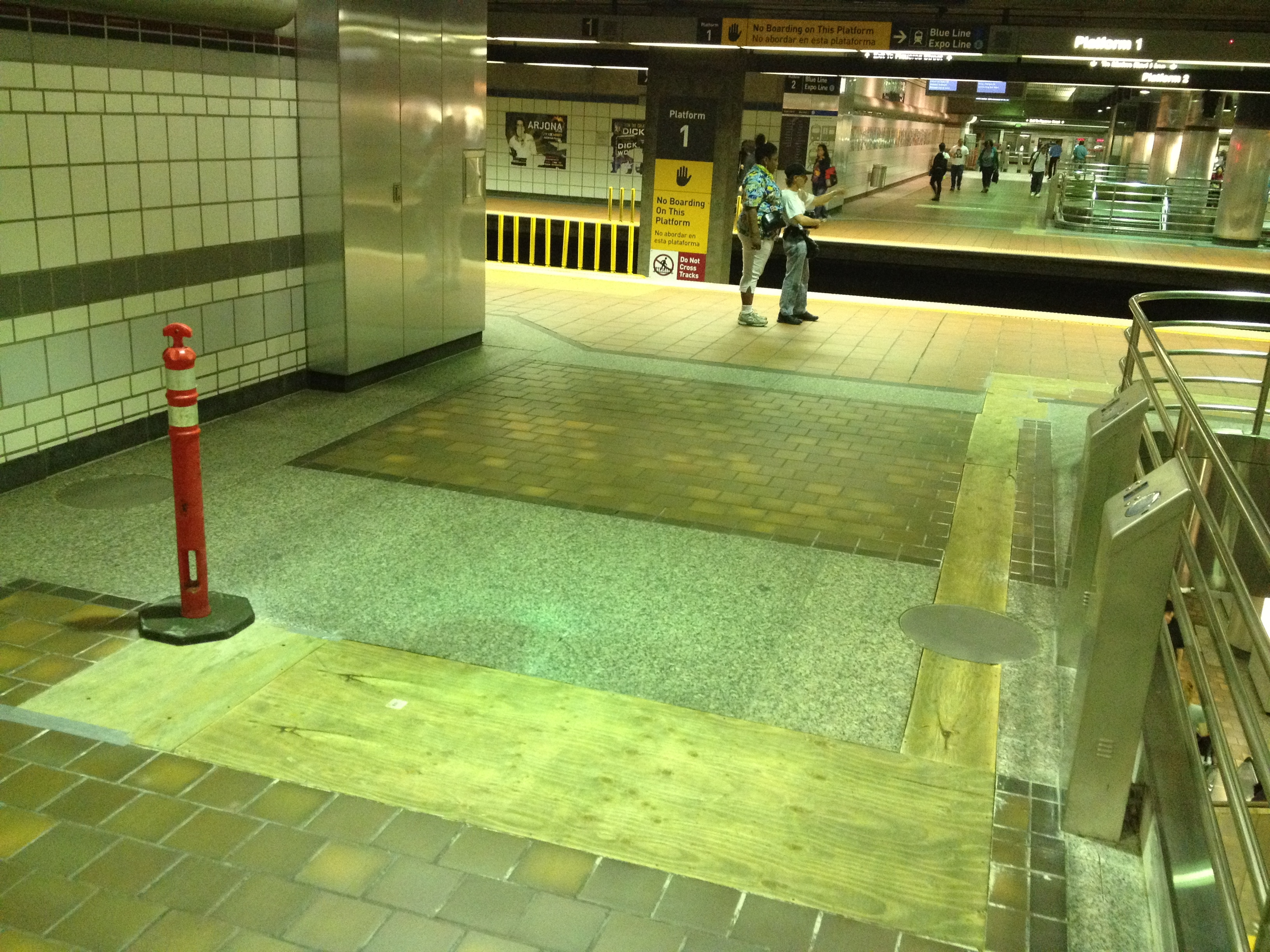 Early construction work involved removing a section of floor to install wires for the validators. Photo: Metro.