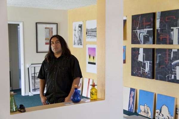 Ramon Ramirez in his Pico Rivera studio. His poster design is visible pinned to the wall behind him.