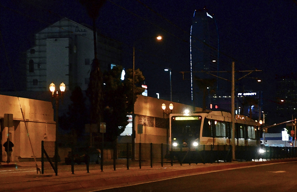 A photo illustration of the Expo Line at night on Flower Street. By Steve Hymon/Metro.