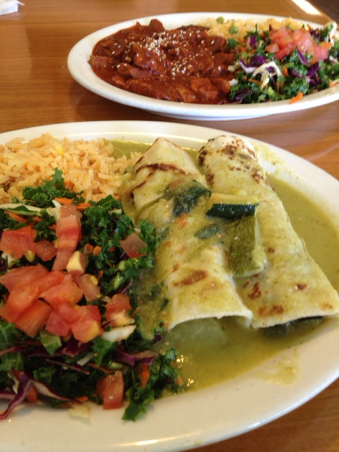 Veggie enchiladas (front) mole plate (back) at Cinnamon in Highland Park.