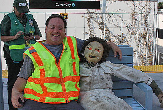 Dwight Sturtevant, aka Expo Line Fan, on the other side of the camera with Metro's crash dummy, Ms. Deb. Photo courtesy of ZevWeb.