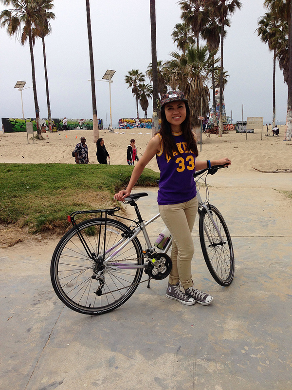 Maria poses with her bike at Venice Beach.