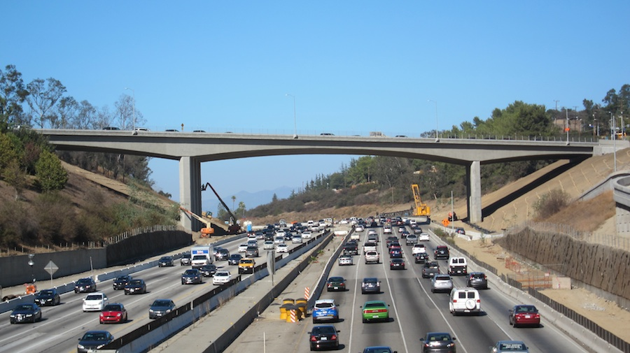 The seismically updated Mulholland Bridge now allows the construction of a extra traffic lane below.