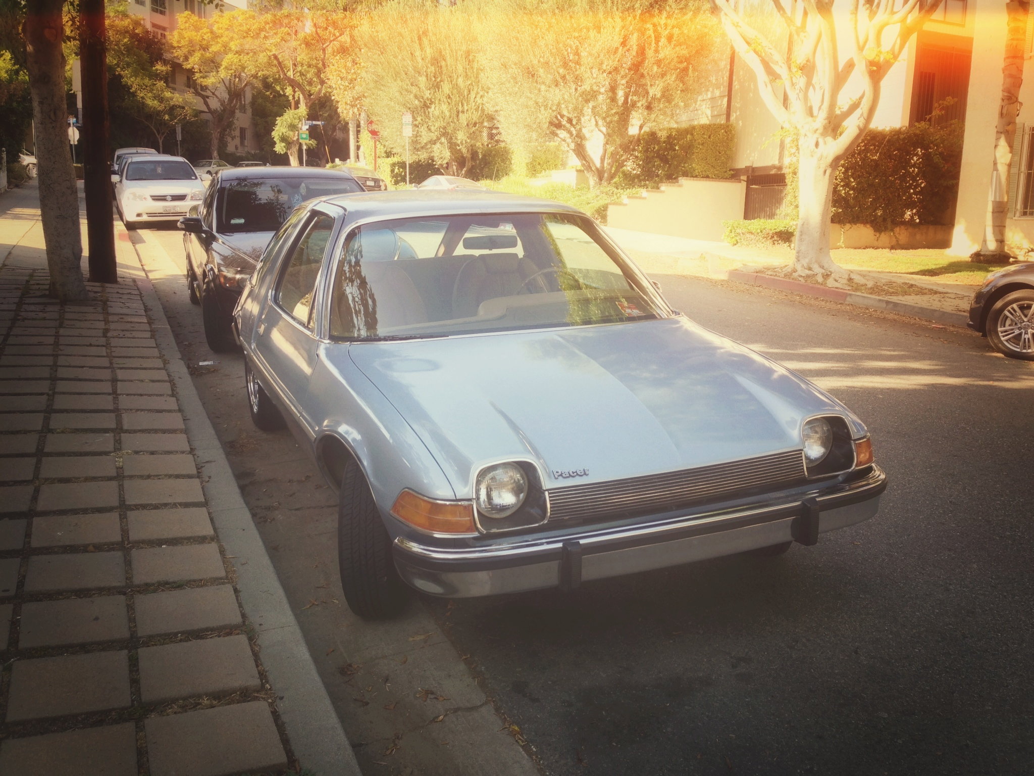ART OF TRANSIT: You don't see too many AMC Pacers around anymore; I saw this one parked on a local street with an ad in the window offering it for film shoots. Smart! I took the photo with my iPhone and used Snapseed's Retrolux feature to make it look like something shot in the 1970s.
