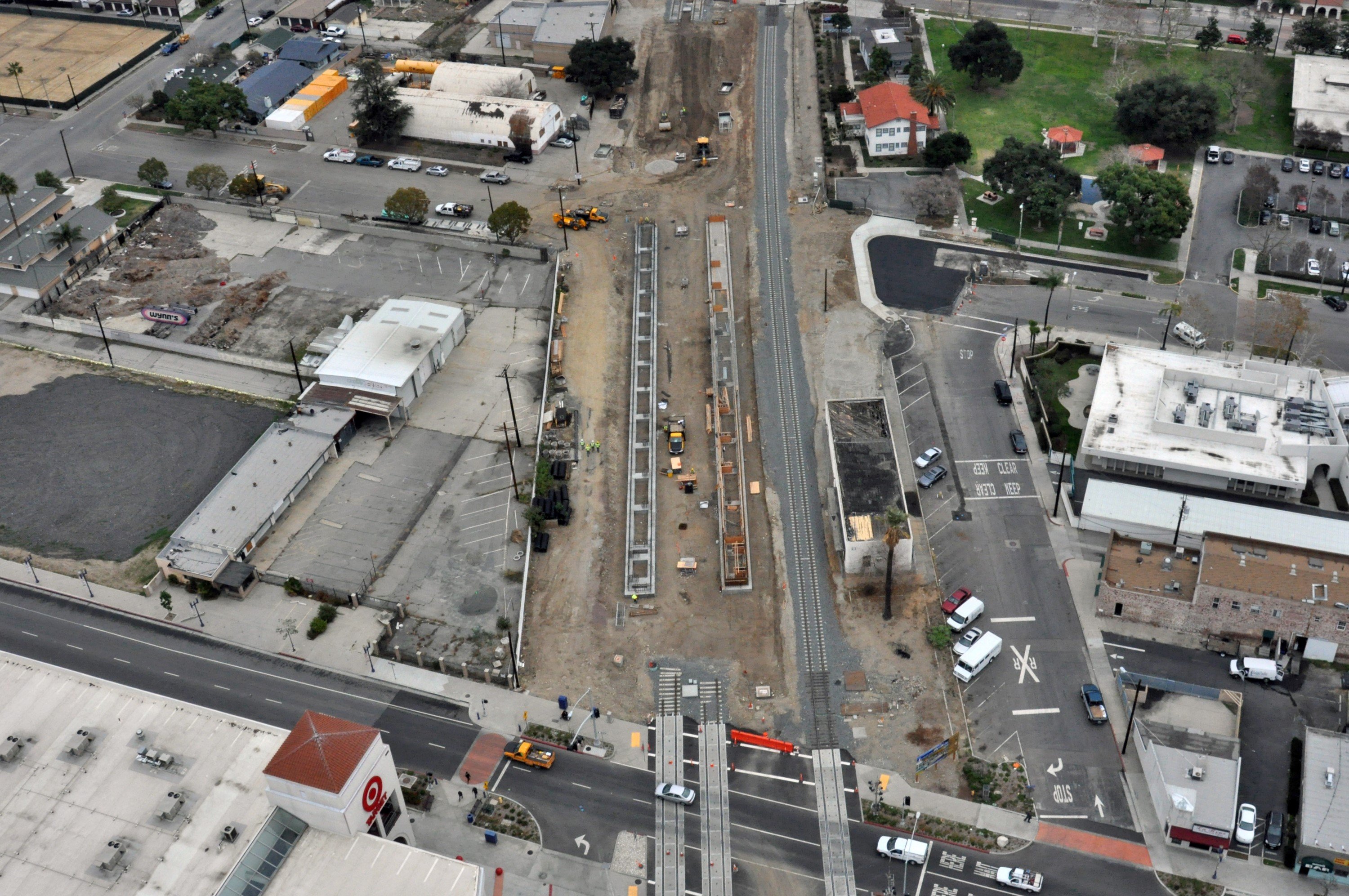 The Gold Line platforms in downtown Azusa next to the old Santa Fe depot along with the newly realigned freight track.