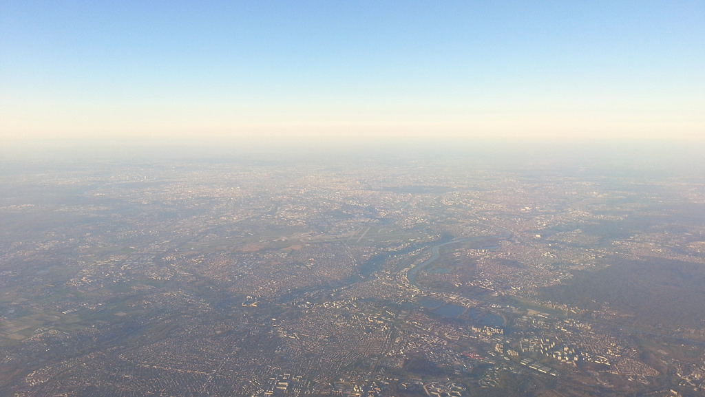 Smog hanging over Paris as seen from an airplane on Sunday. Photo by F.Clerc via Flickr creative commons.