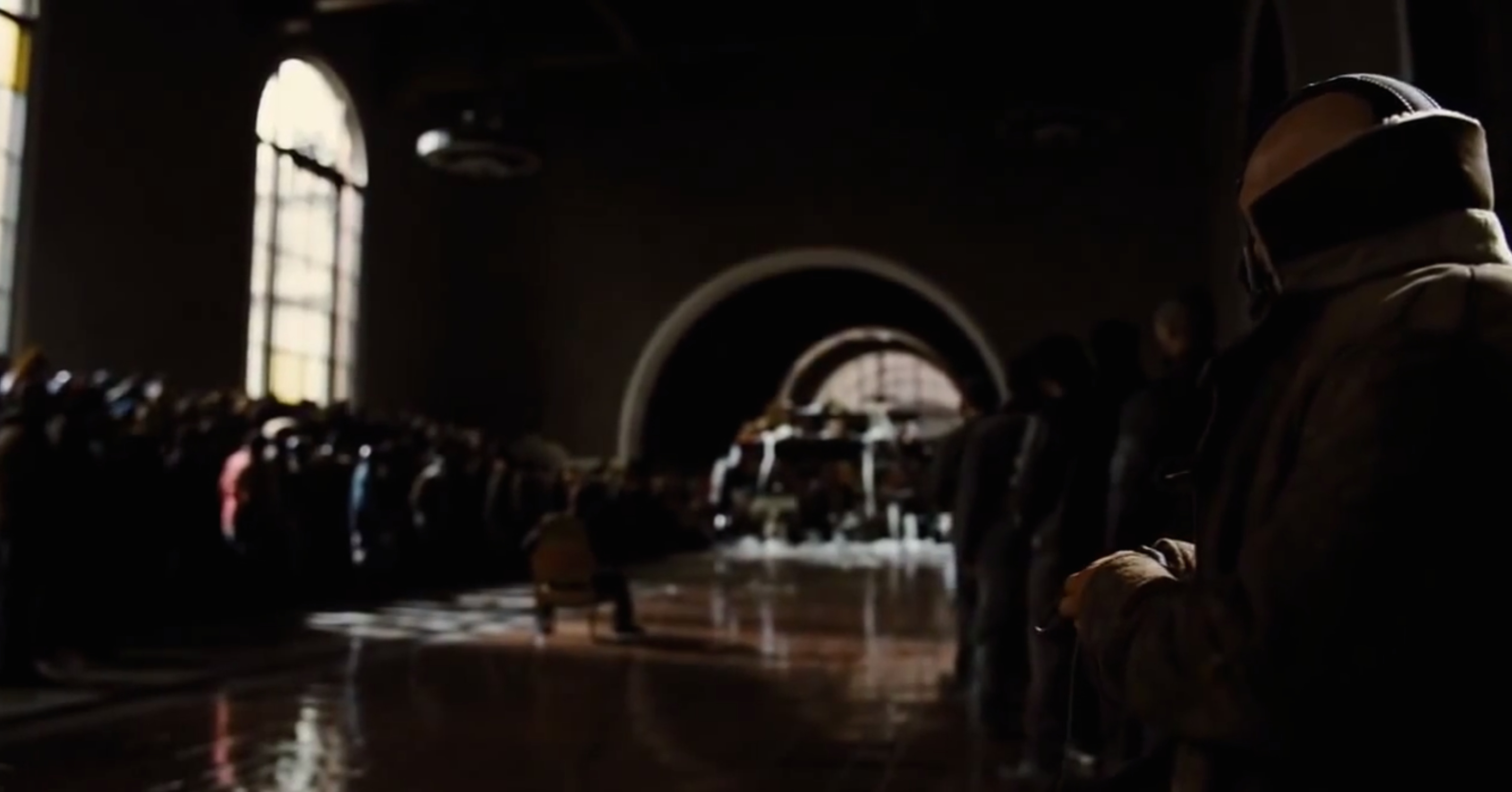 "A scene from the ""The Dark Knight Rises"" that was filmed in the old ticket room  at Union Station. Credit: Warner Bros."
