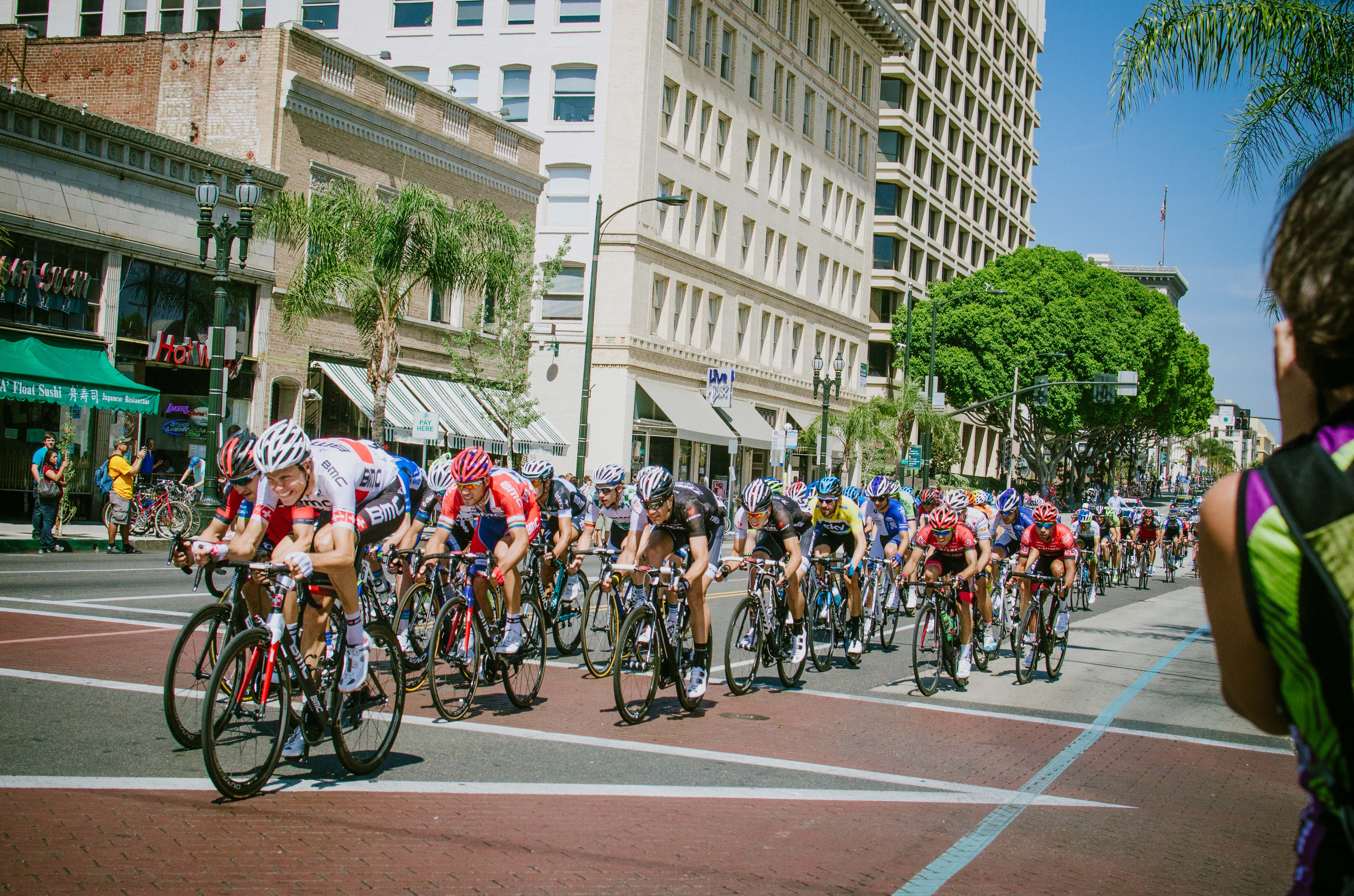 ART OF TRANSIT: The peloton makes its way down Colorado Boulevard in Old Pasadena on Saturday during Stage 7 of the Tour of California. Two nearby Gold Line stations helped bring crowds to see the end of the stage. Photo by Steve Hymon.