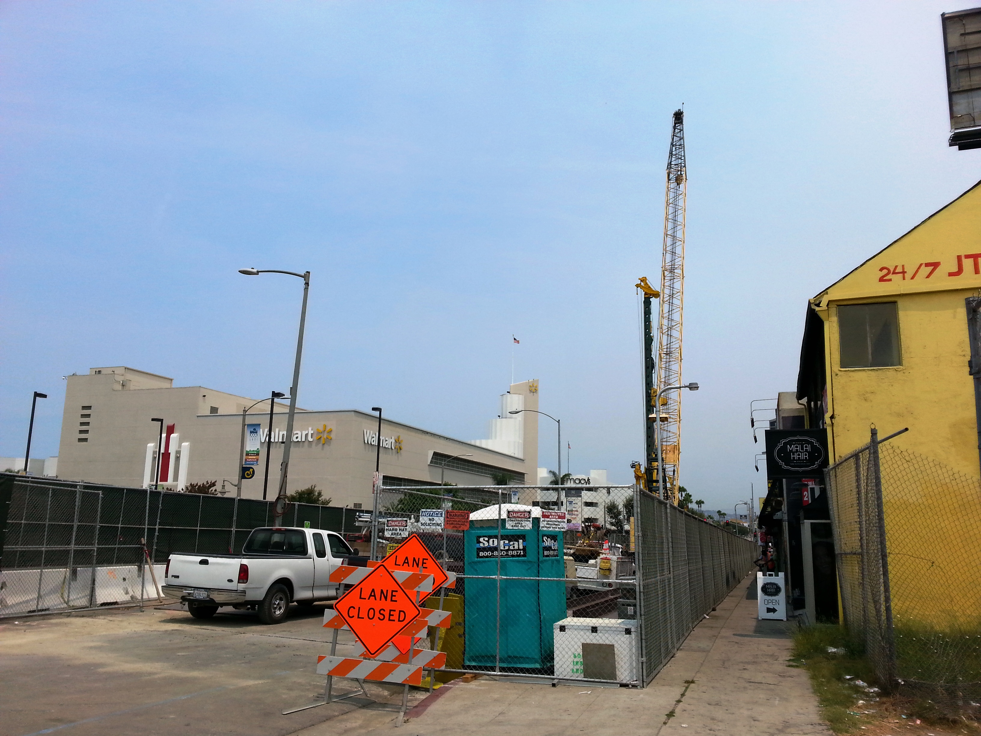 View of construction along Crenshaw Boulevard just north of Stocker Street. There is pedestrian access to businesses.