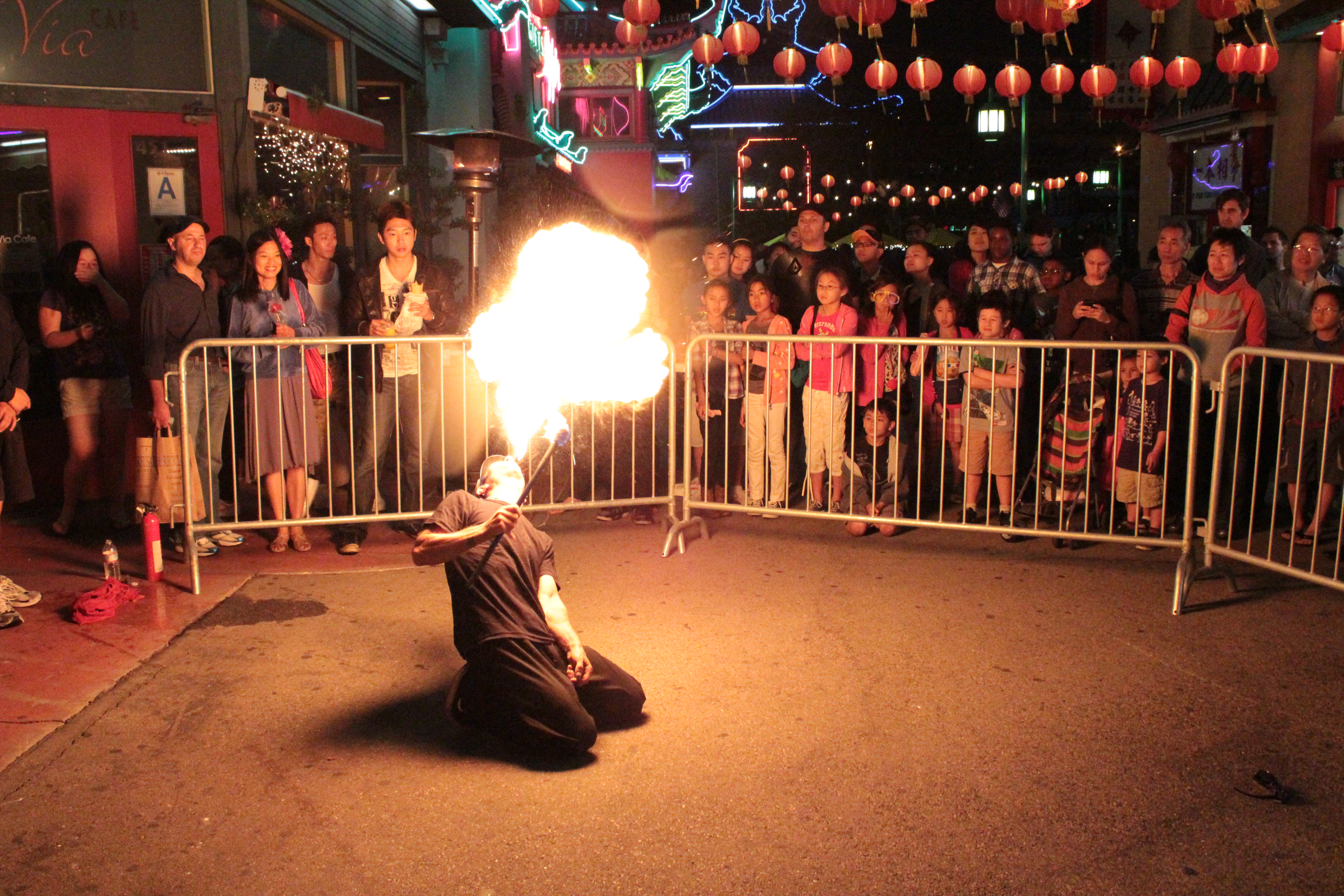 Breathing fire for a captive audience at Chinatown Summer Nights. Photo by Salina Canizales via Flickr/CC.