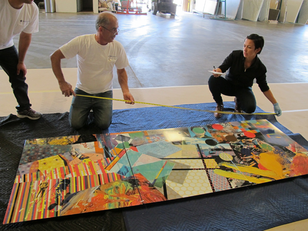 Campuzano and Arthur and Oksen Yegyan of Oksen Tile carefully measure one of the artwork panels