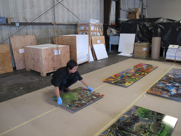 Metro Art Manager Angelene Campuzano carefully reviews each of the artwork panels received from the fabricator.