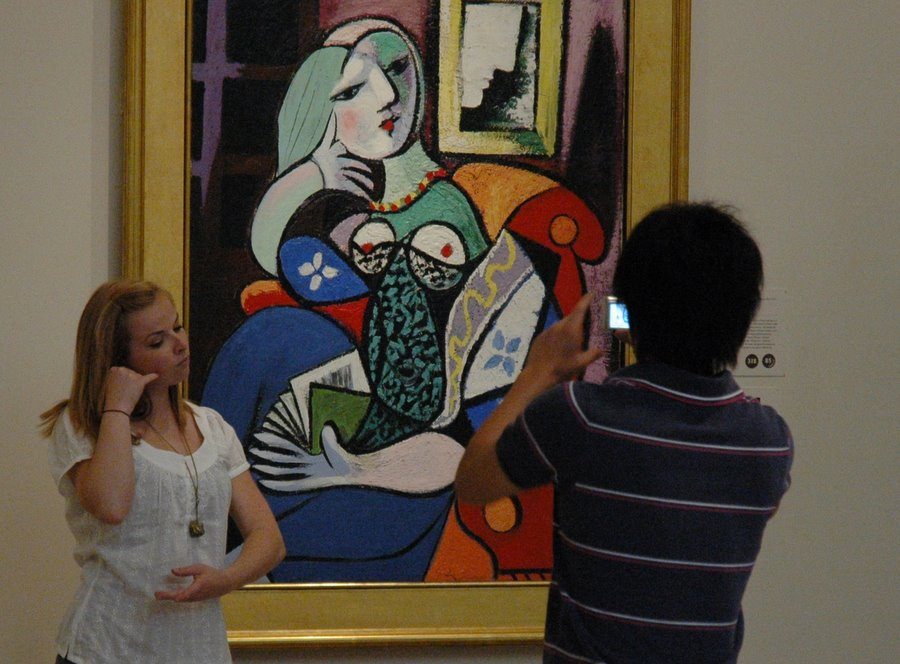 Visitors pose with Picasso's portrait of Marie Therese at the Norton Simon Museum, one of many Pasadena museums, galleries, and cultural institutions open late on ArtNight. Image by Glenn Zucman via Flickr/CC
