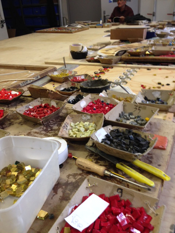 Thousands of tiny mosaic tiles are prepared to handset into ceramic tiles.  Photo Credit: Mayer of Munich