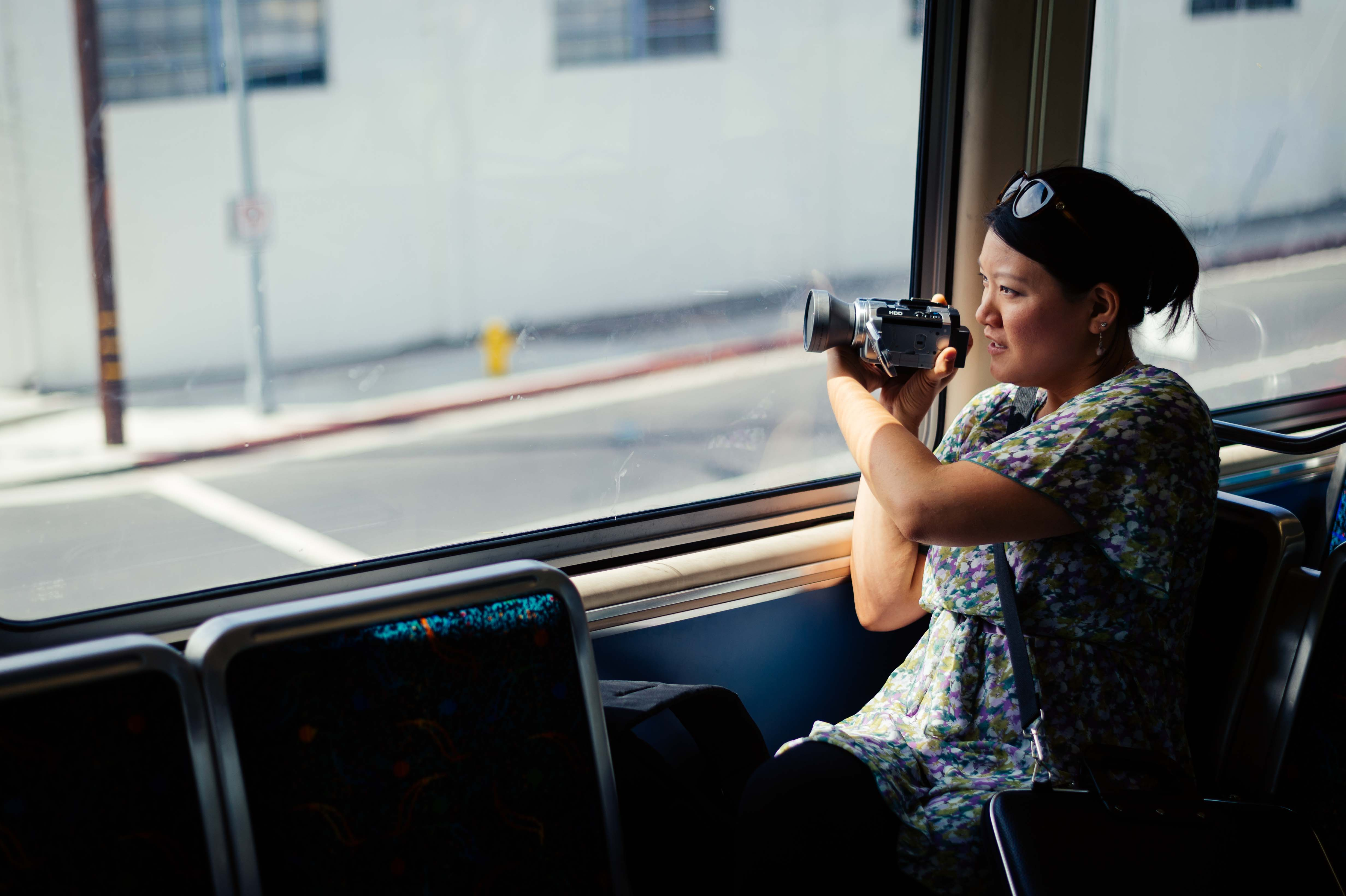 Art of Transit: My colleague Anna Chen collecting footage on the Expo Line for a video to promote ride sharing. Click above for recent posts on Rideshare Week. Photo by Steve Hymon/Metro.