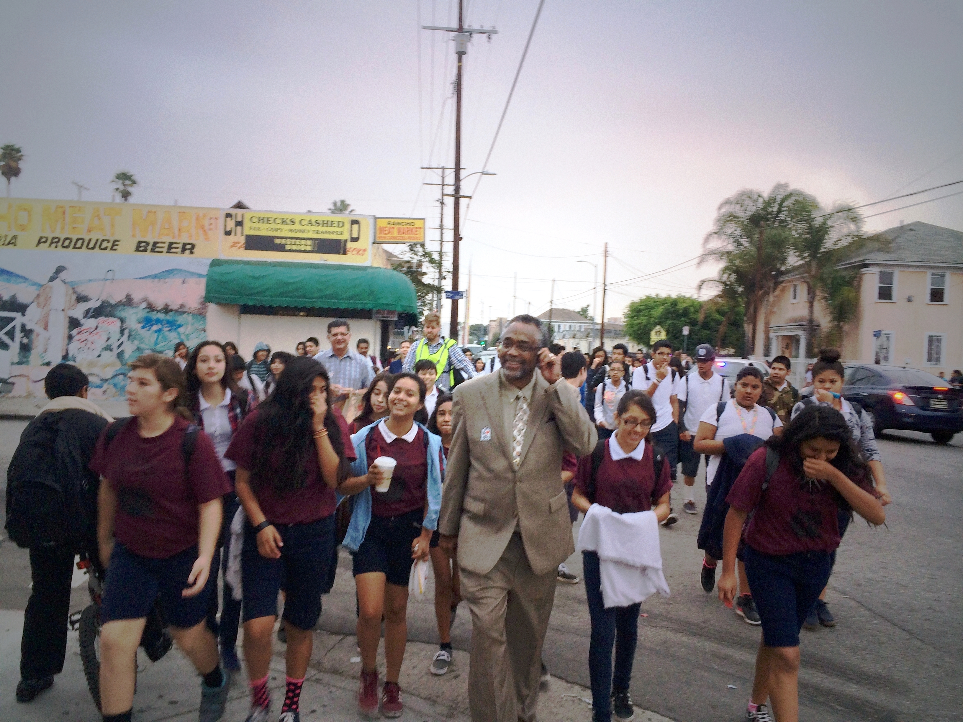 Councilmember Price walking with students