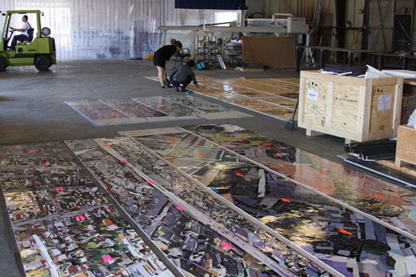 Inspection of artwork panels after delivery by the fabricator to ensure that the colors of the original artwork are accurately reflected in ceramic mosaic and that the color is consistent among all of the panels.