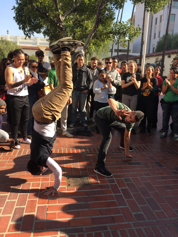 "Two capoeiristas play inside a ""roda"" or circle, comprised of other players,  musicians and audience members at Metro Presents: Capoeira Exchange on Jan. 3 at Union Station"