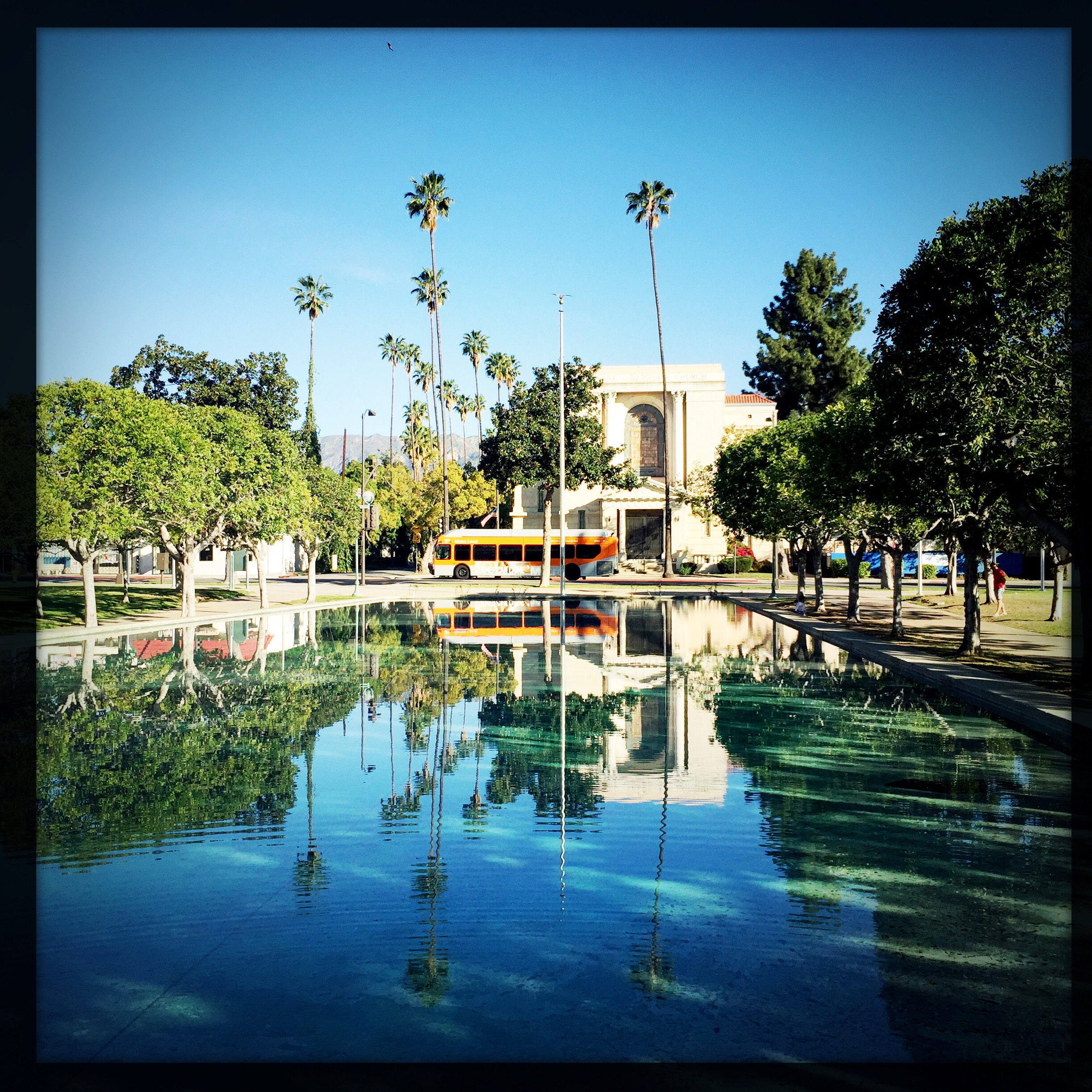 ART OF TRANSIT: The Metro Local 181 passes by the fountain at Pasadena City College on Saturday morning. Photo by Steve Hymon/Metro.