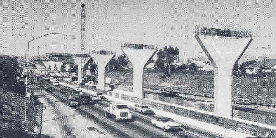Construction of the elevated portion of the Harbor Transitway on the 110 freeway south of DTLA. Photo: Metro Library.