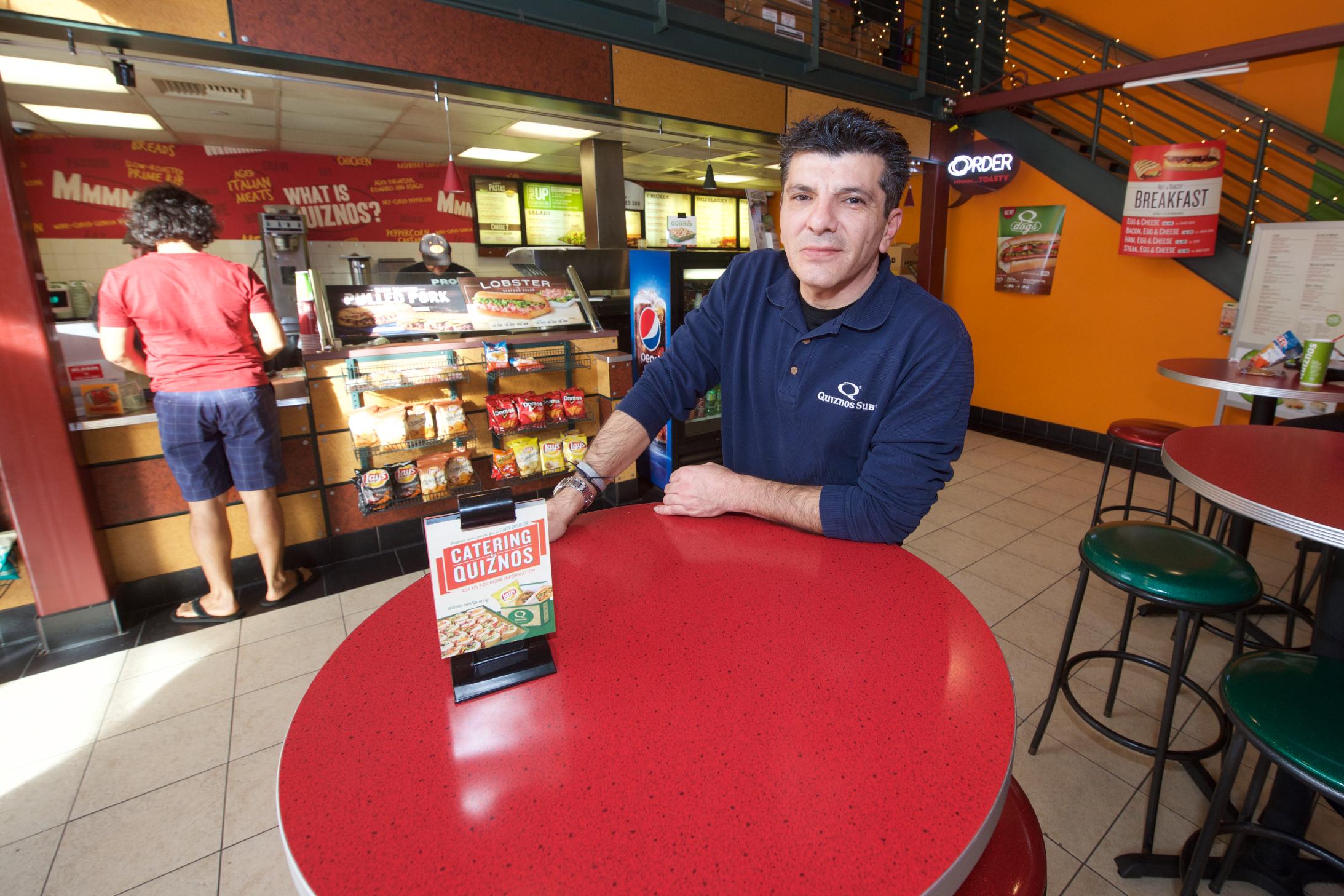 Andre Bonyadian at Quizno's. Photo by Gary Leonard/Metro.