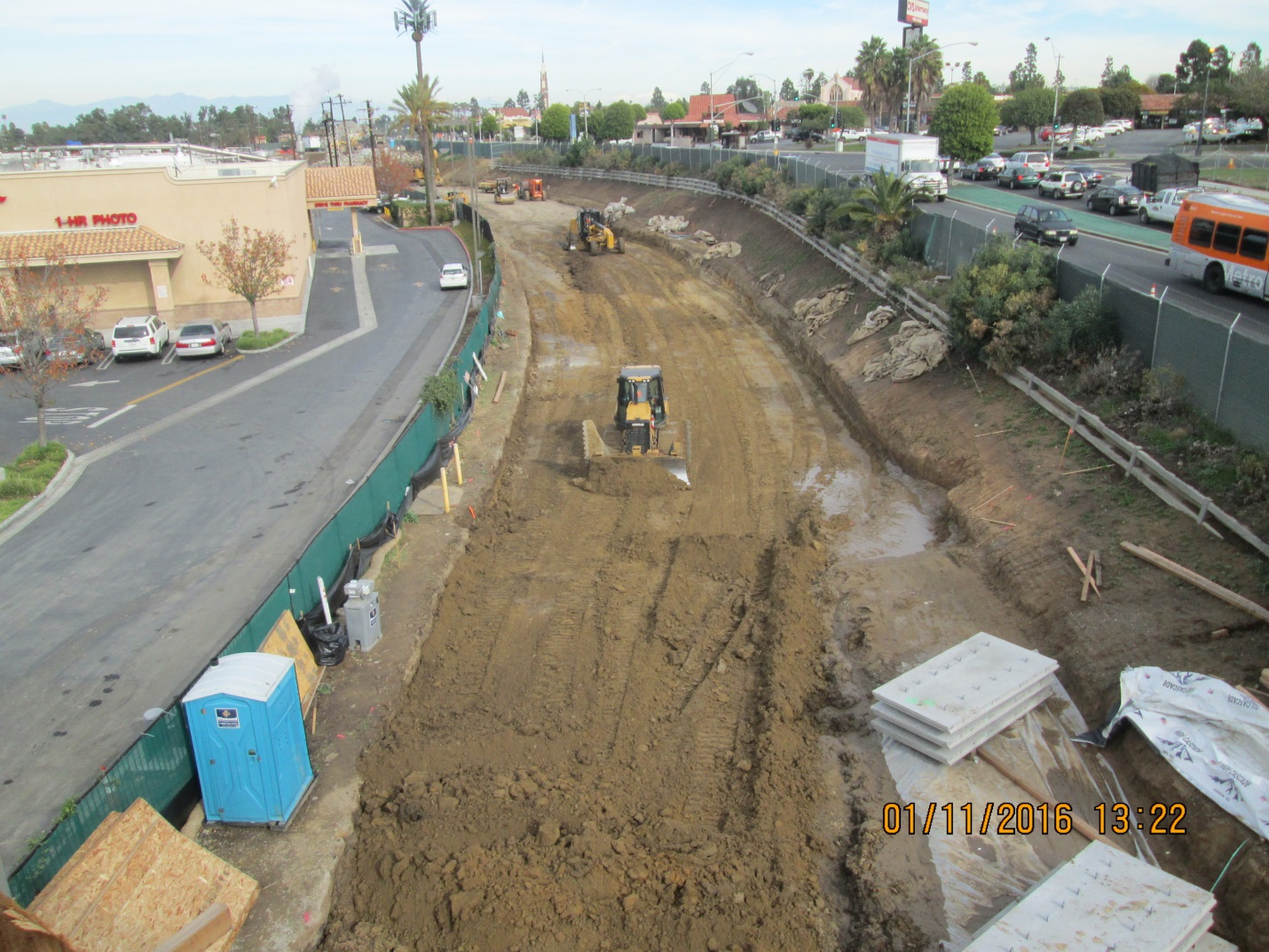 Work on the right-of-way that will run adjacent to Florence Avenue, at right.