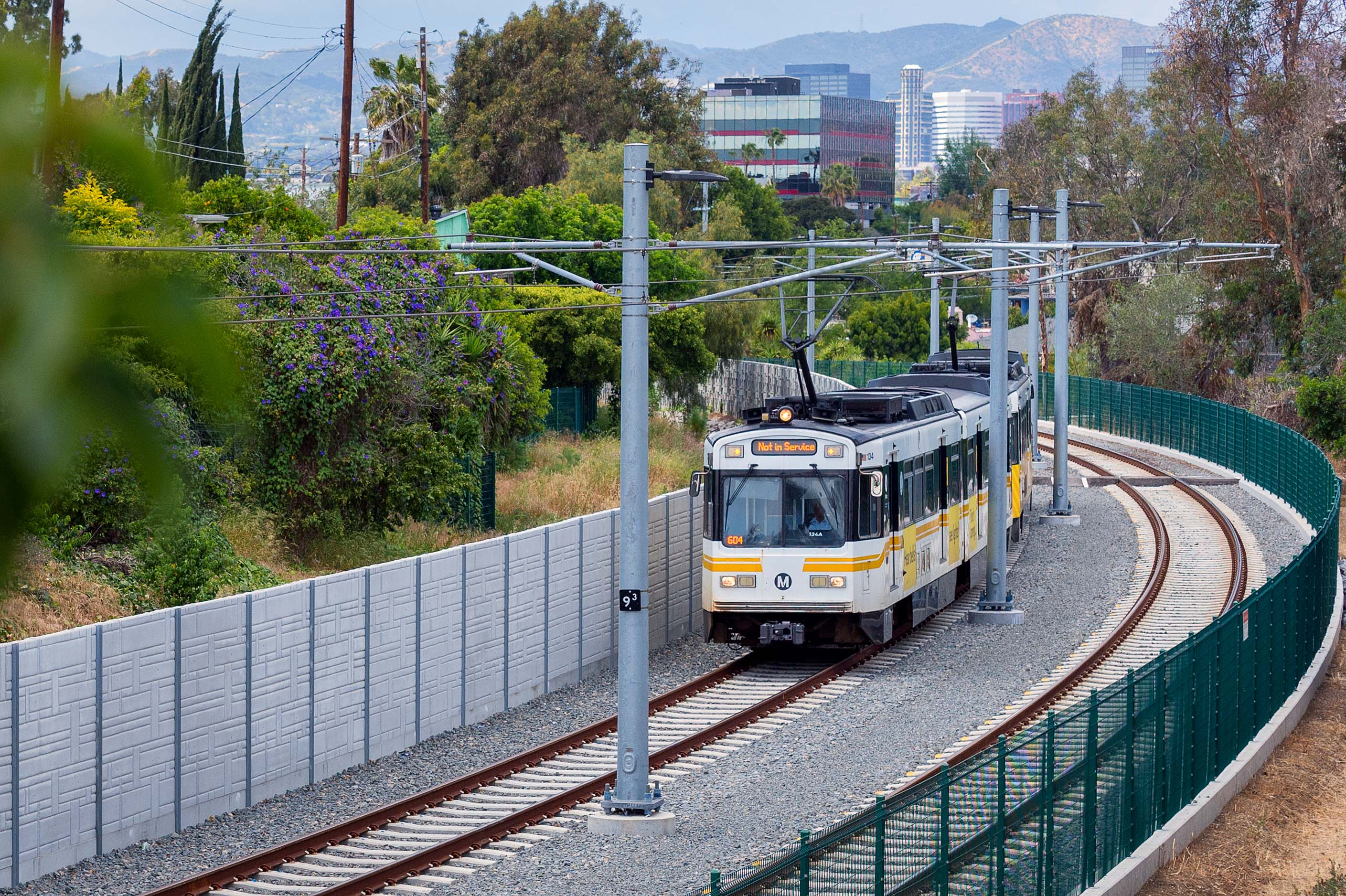 An eastbound Expo Line test train with the towers of Westwood in the background. Photo by Steve Hymon/Metro.