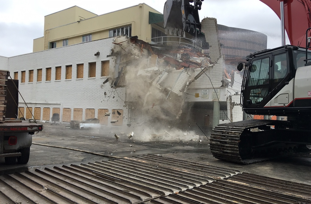 Work is underway on demolishing one residential building and two commercial properties to make way for two construction staging yards near the future Wilshire/La Cienega Station for the Purple Line Extension. Photo: Metro.