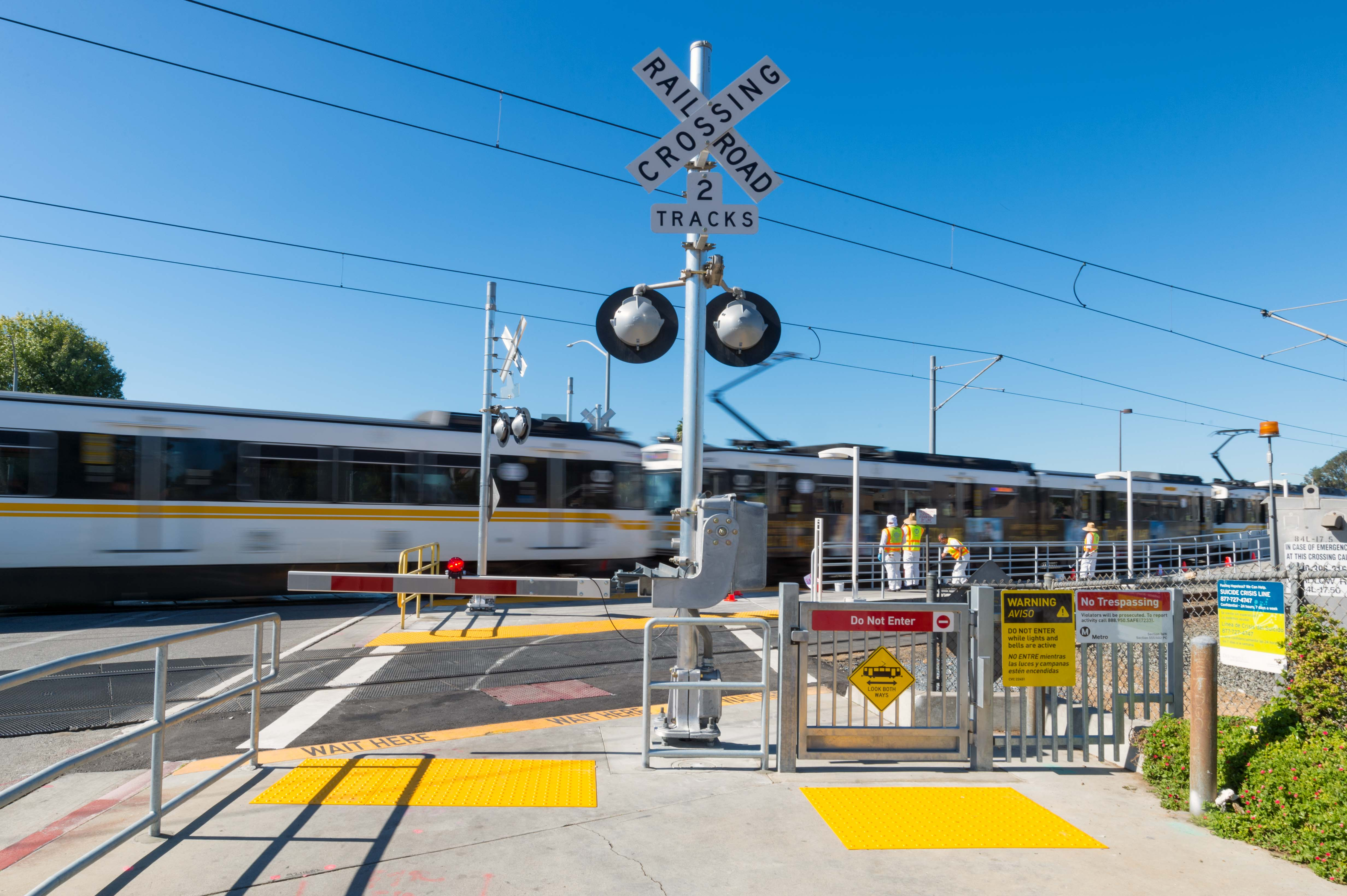 New gates designed to slow and/or stop pedestrians from crossing the tracks at the Blue Line's Wardlow Station. Photo by Steve Hymon/Metro.
