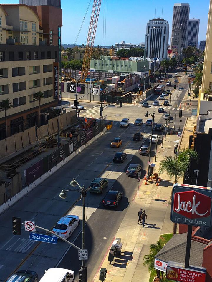 A good view of the completed decking on Wilshire Boulevard for the future Wilshire/La Brea Station for the Purple Line Extension. The decking allows traffic to flow while station excavation continues underneath. Photo: Metro.