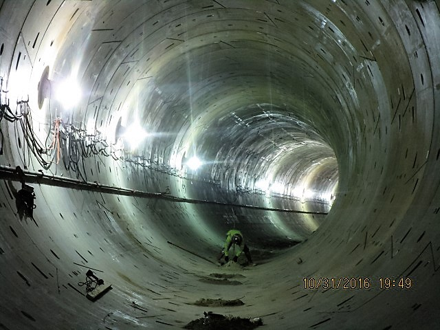 tunneling-removed-temporary-rail-and-vent-lines-to-prepare-for-invert-pour-of-completed-tunnel