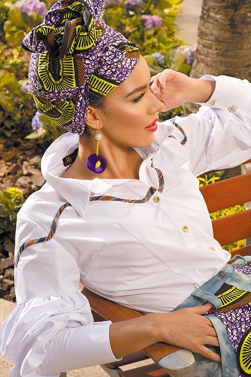 Blusa con volumen en las mangas y pantaloneta de la colección Traveling Artist inspirada en mix de culturas africana y guatemalteca. Raul Briceño Pendientes hechos a mano por artesanos guatemaltecos. AA collection.a by Raul Briceño
