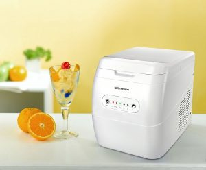 Emerson Portable Ice Maker IM92W - image shows size of the machine in relation to an wine glass
