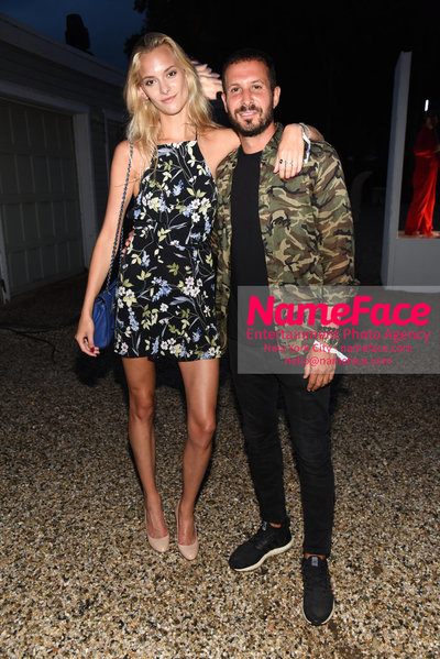 NY: 23rd Annual Watermill Center Summer Benefit & Auction Stephanie Rad and Guest - NameFace Photo Agency New York City - hello@nameface.com - nameface.com - Photo by Steve Eichner
