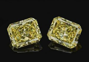 Twin 10-carat, fancy-yellow, radiant-cut Alrosa diamonds