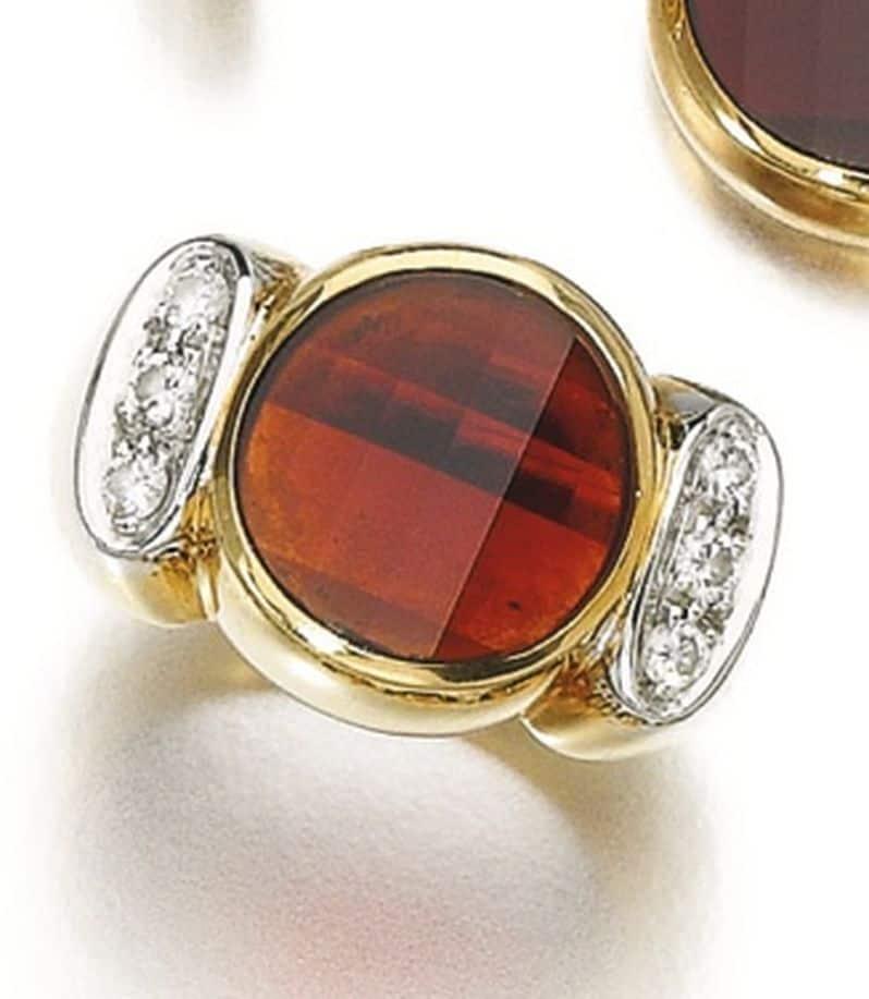 Lot 198 - Ring of the Garnet and Diamond Demi-Parure by Pomellato