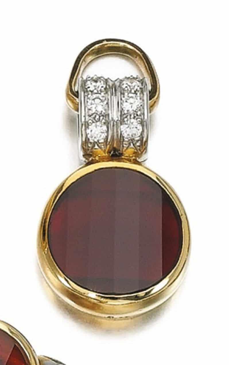 Lot 198 - Pendant of the Garnet and Diamond Demi-Parure by Pomellato