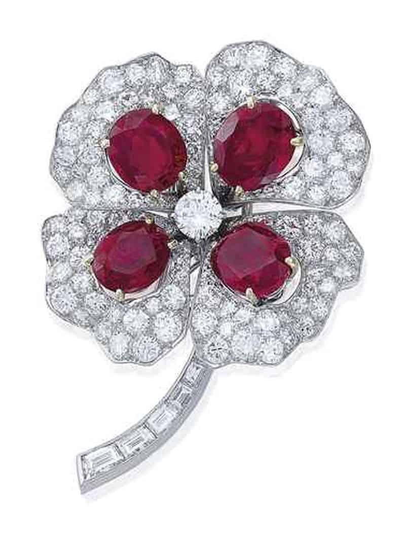 Lot 231 - A RUBY AND DIAMOND 'TRÈFLE À QUATRE FEUILLES' BROOCH, BY BOUCHERON