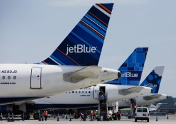 Passengers exit a JetBlue Airways Corp. plane at Long Beach Airport (LGB) in Long Beach, California, U.S., on Monday, July 22, 2013. JetBlue Airways Corp. is scheduled to release earnings figures on July 30. Photographer: Patrick T. Fallon/Bloomberg via Getty Images